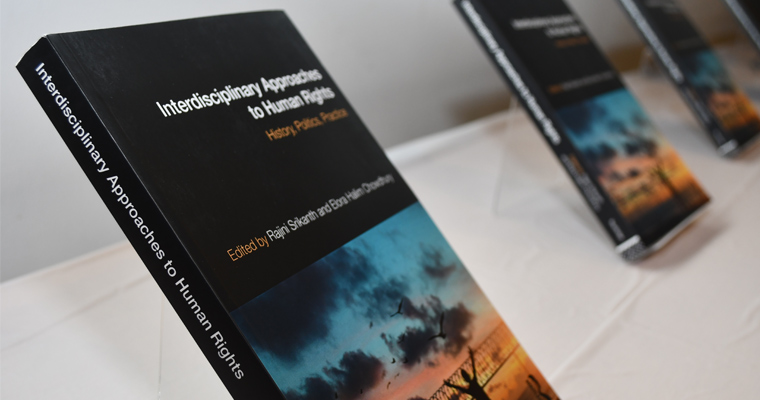 Covers of Approaches to Human Rights: History, Politics, Practice, lined up for the book launch party